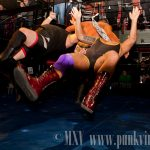 Harry Smith clotheslines The Sheik and Kevin Steen